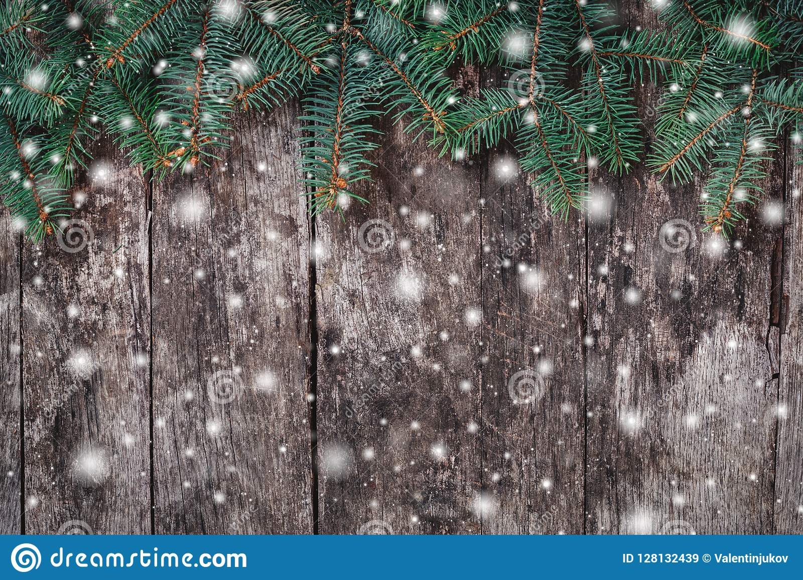 Christmas Fir branches on wooden background. Xmas and Happy New Year composition.