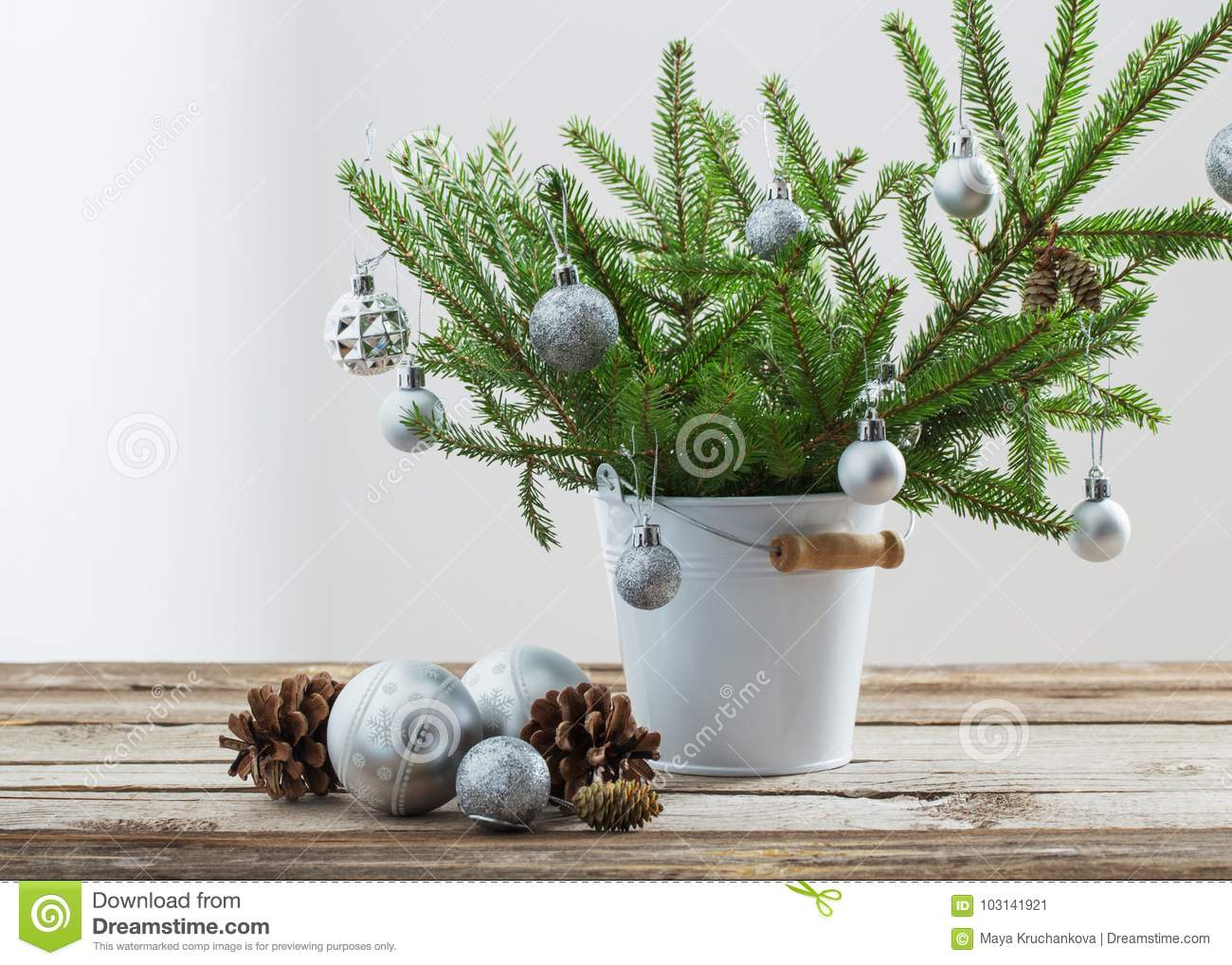 Christmas fir in bucket on old wooden table stock image image of