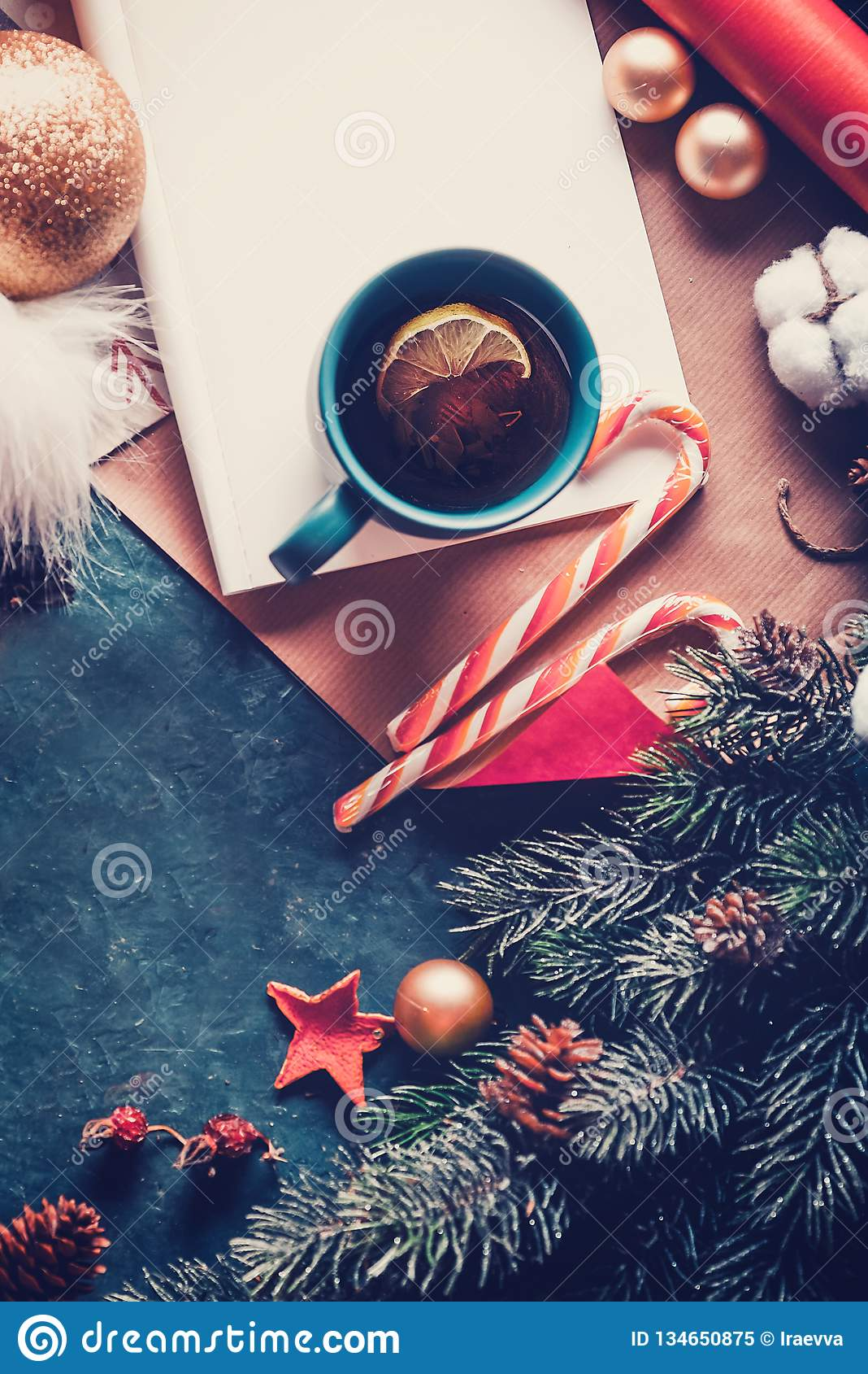 Christmas fir tree, decorations and hot tea with lemon. A letter to Santa Claus. View from above