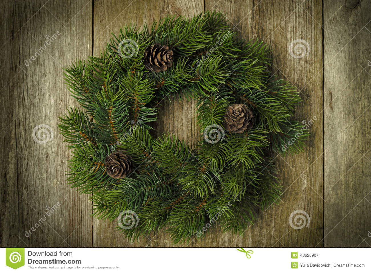 Christmas fir wreath on vintage wooden background, horizontal