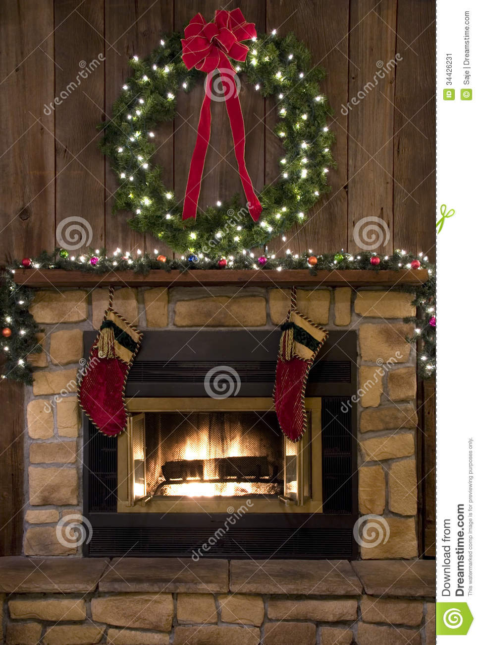 christmas fireplace hearth with wreath and stockings stock image