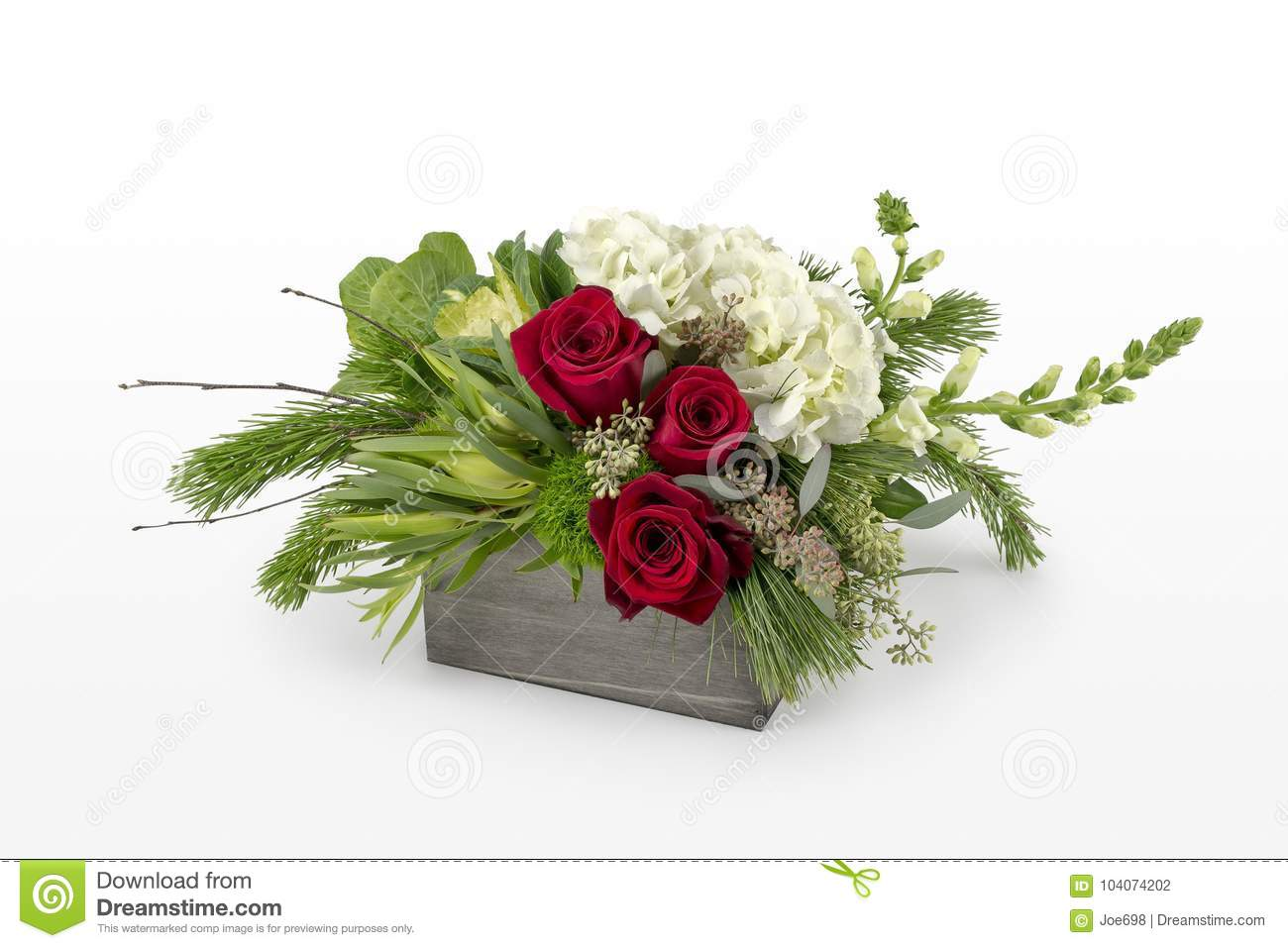 Christmas Flower Arrangement With Red Roses And Mixed Holiday Greens