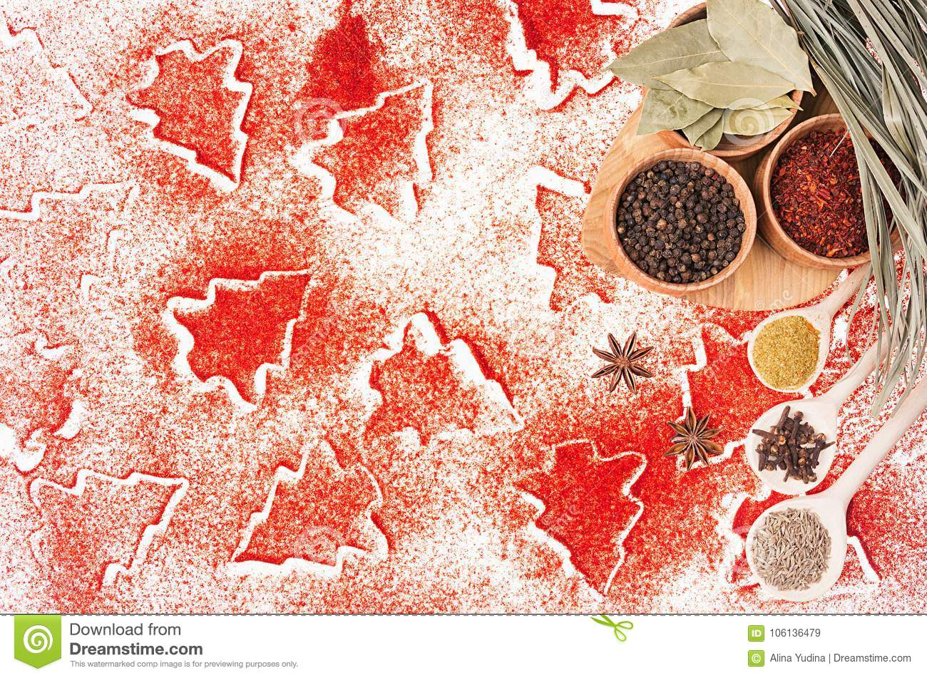 Christmas food background - different dry spices in wooden bowls on red christmas trees pattern, top view, copy space.