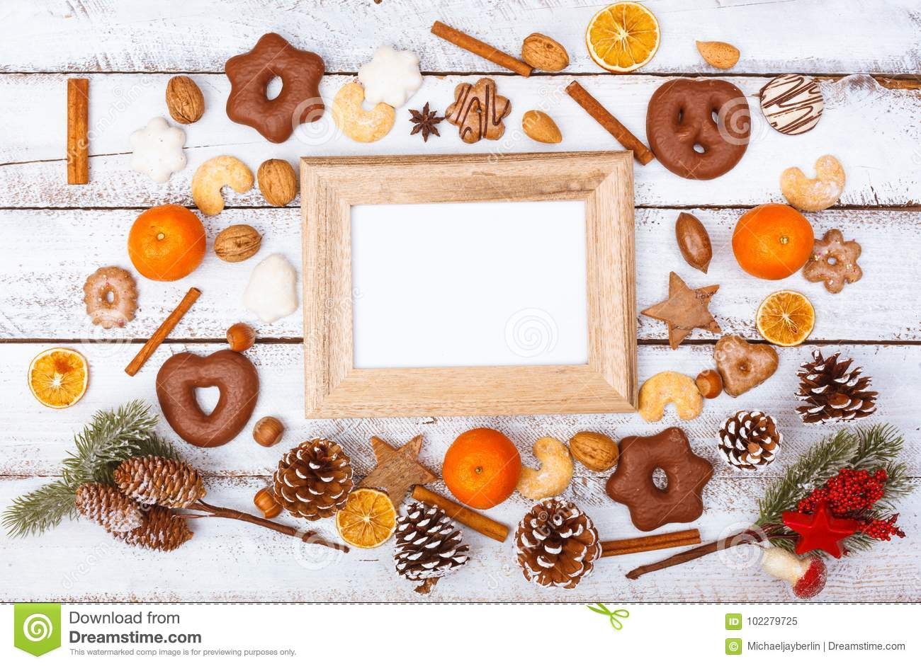 Christmas food flat lay with photo frame on white table
