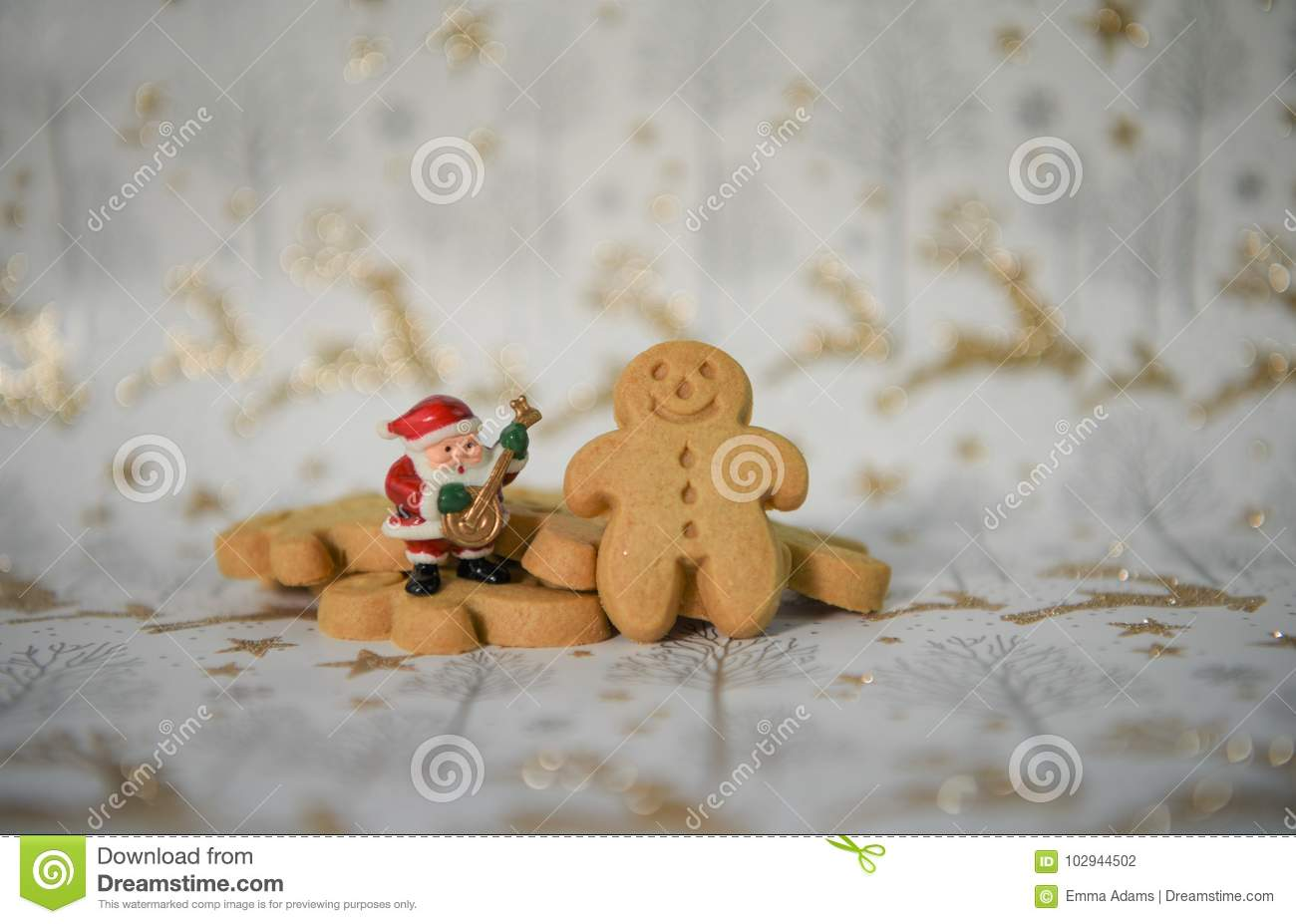 Christmas food photography gingerbread man mini music santa claus on gold reindeer glitter xmas wrapping paper background