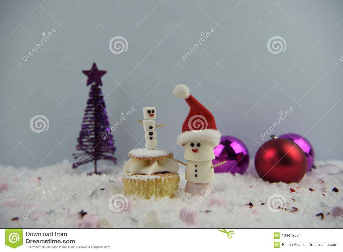 download christmas food photography using marshmallows shaped as snowman and standing in snow with cream sponge