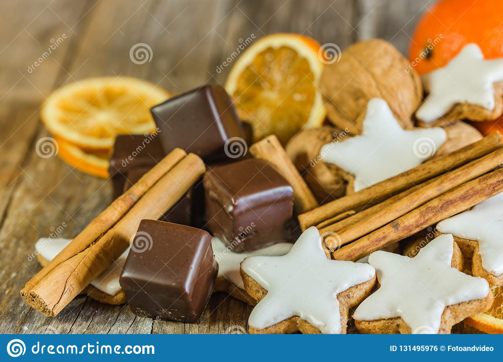Christmas Food Star Biscuits Chocolate And Spices On Wooden Table