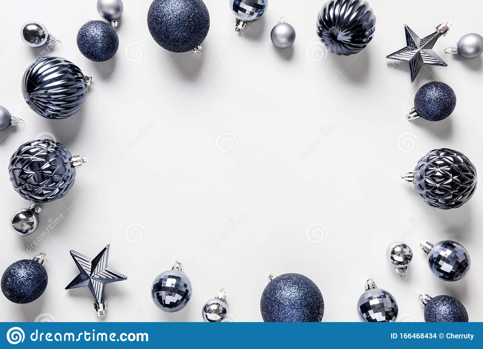 christmas frame of classic blue balls on grey top view
