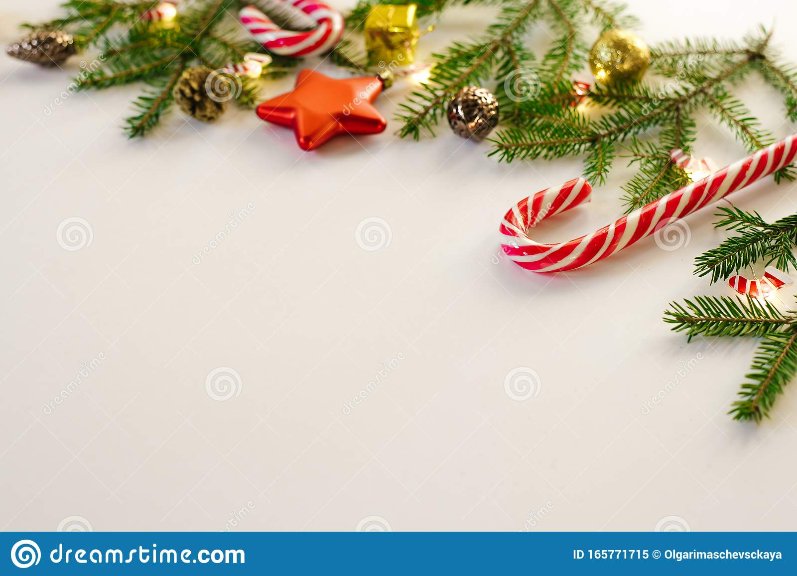 Christmas Frame Of Fir Branches And Gold And Brown Christmas Tree Toys Mint Candy Canes And Burning Lights On White Background C Stock Image Image Of Gold Canes 165771715
