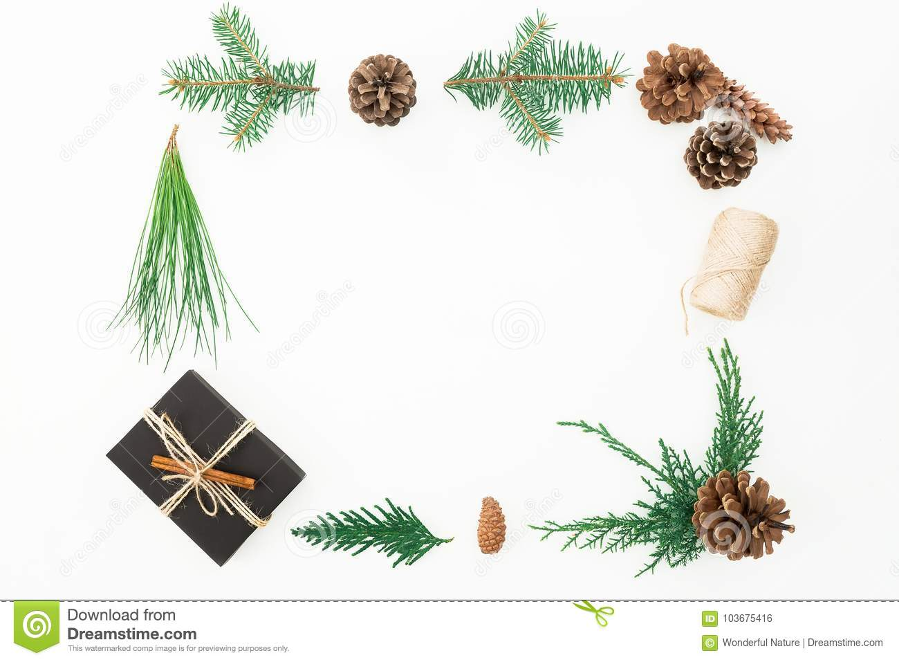 Christmas Frame Made Of Gift Box, Branches Of Tree And Pine Cones On ...
