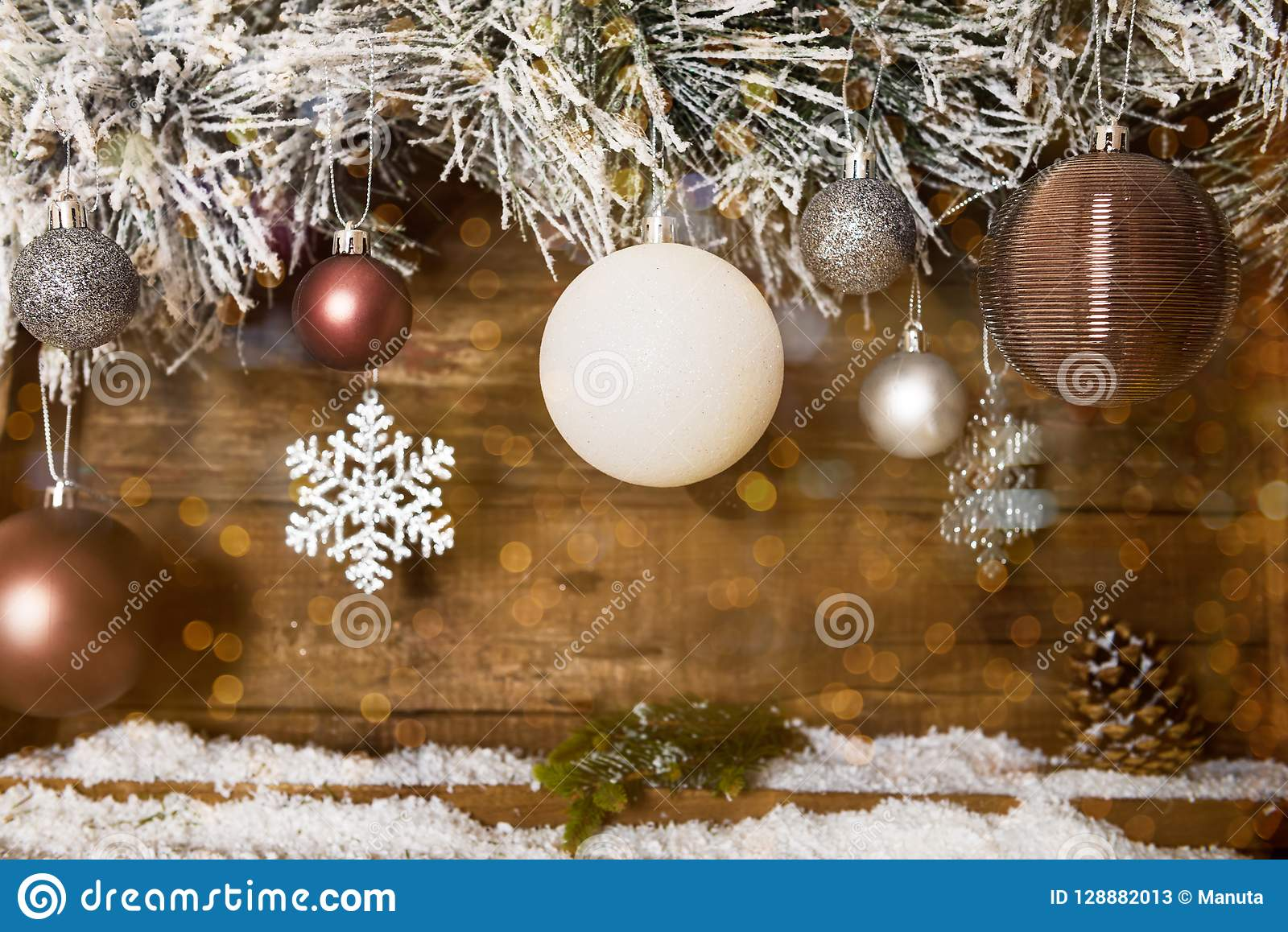 Christmas Frame from Snowy Xmas tree branches and Wooden Calendar