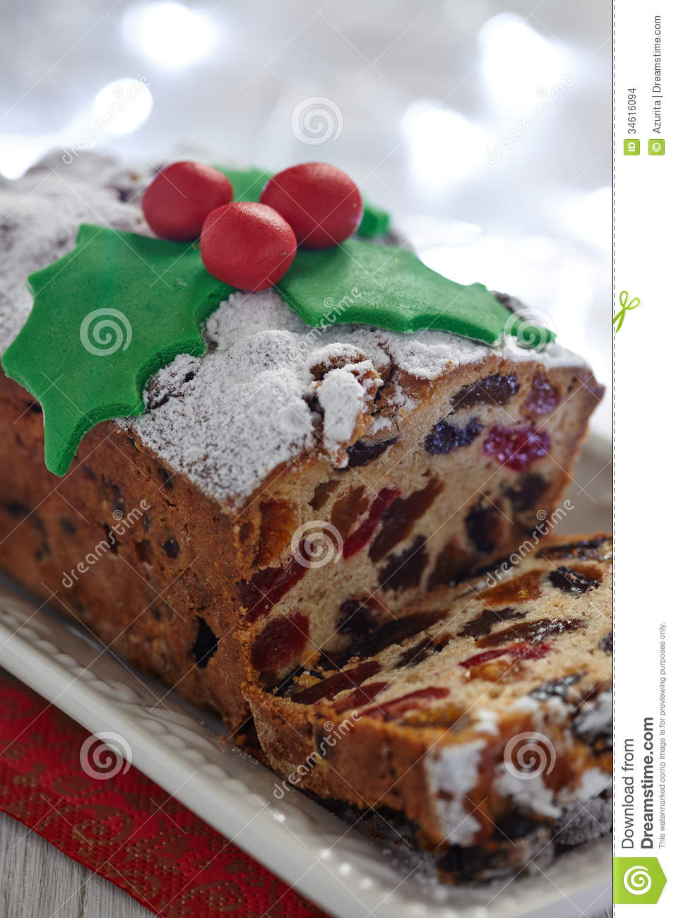 Christmas fruit cake decorated with holly and berries.