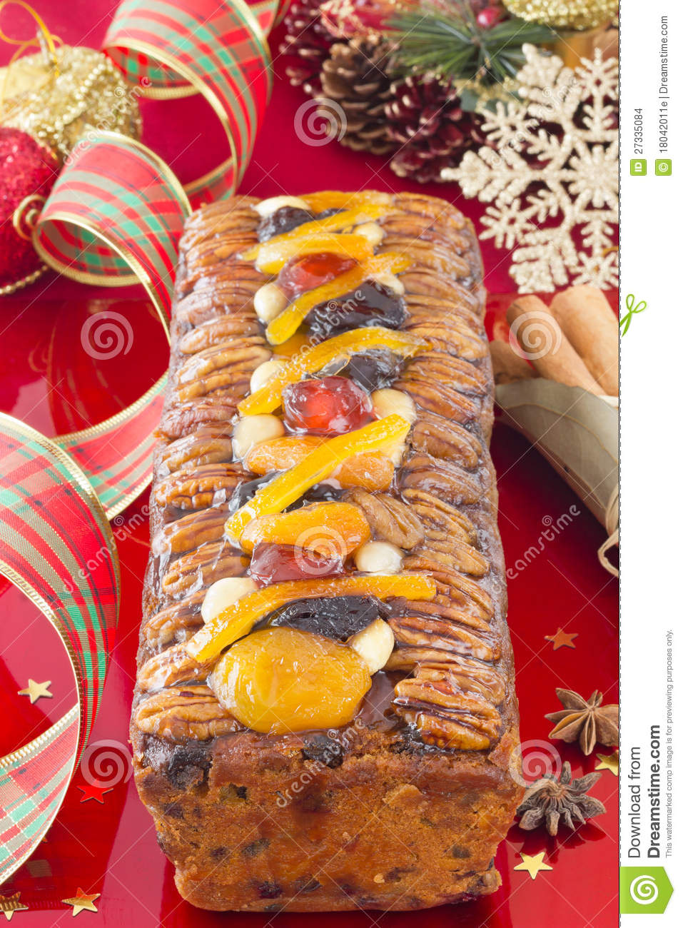 Christmas fruit cake with festive decoration stock images for Baking oranges for christmas decoration