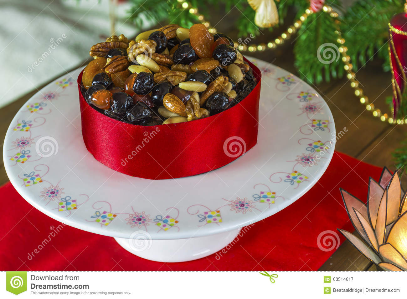 Christmas Cake Decoration With Fruit And Nuts : Christmas Fruit And Nut Cake Stock Photo - Image: 63514617