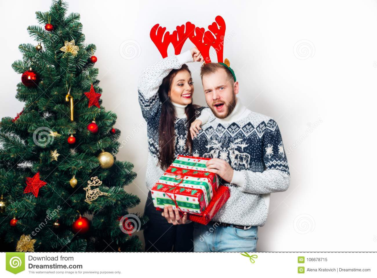 Download Christmas Funny Couple Enjoying In The Holidays And Gifts Stock Image