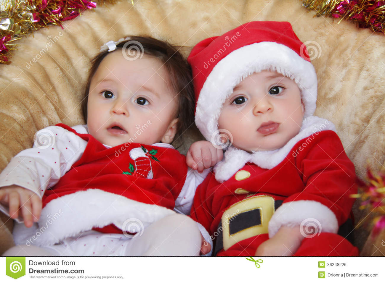 Christmas Funny Small Kids In Santa Claus Clothes. Royalty Free Stock ...