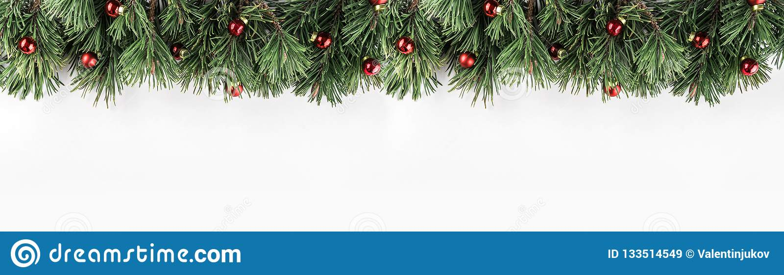 Christmas garland of Fir branches with red decoration on white background. Xmas and Happy New Year theme.