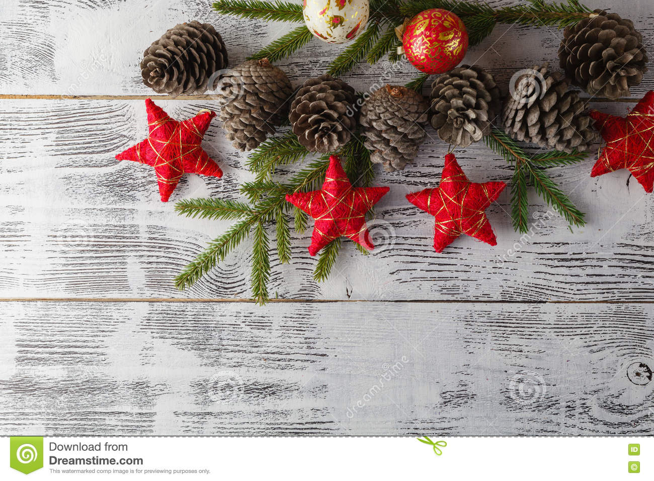 Christmas garland on rustic wooden background with copy