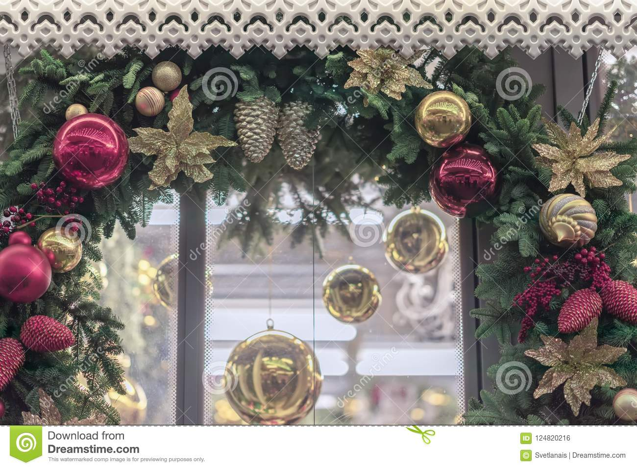 download christmas garland a wreath close up around a window with shiny decorations