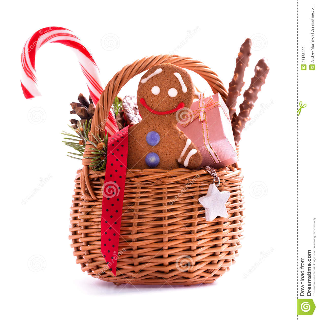 Christmas gift basket with treats and gingerbread man isolated