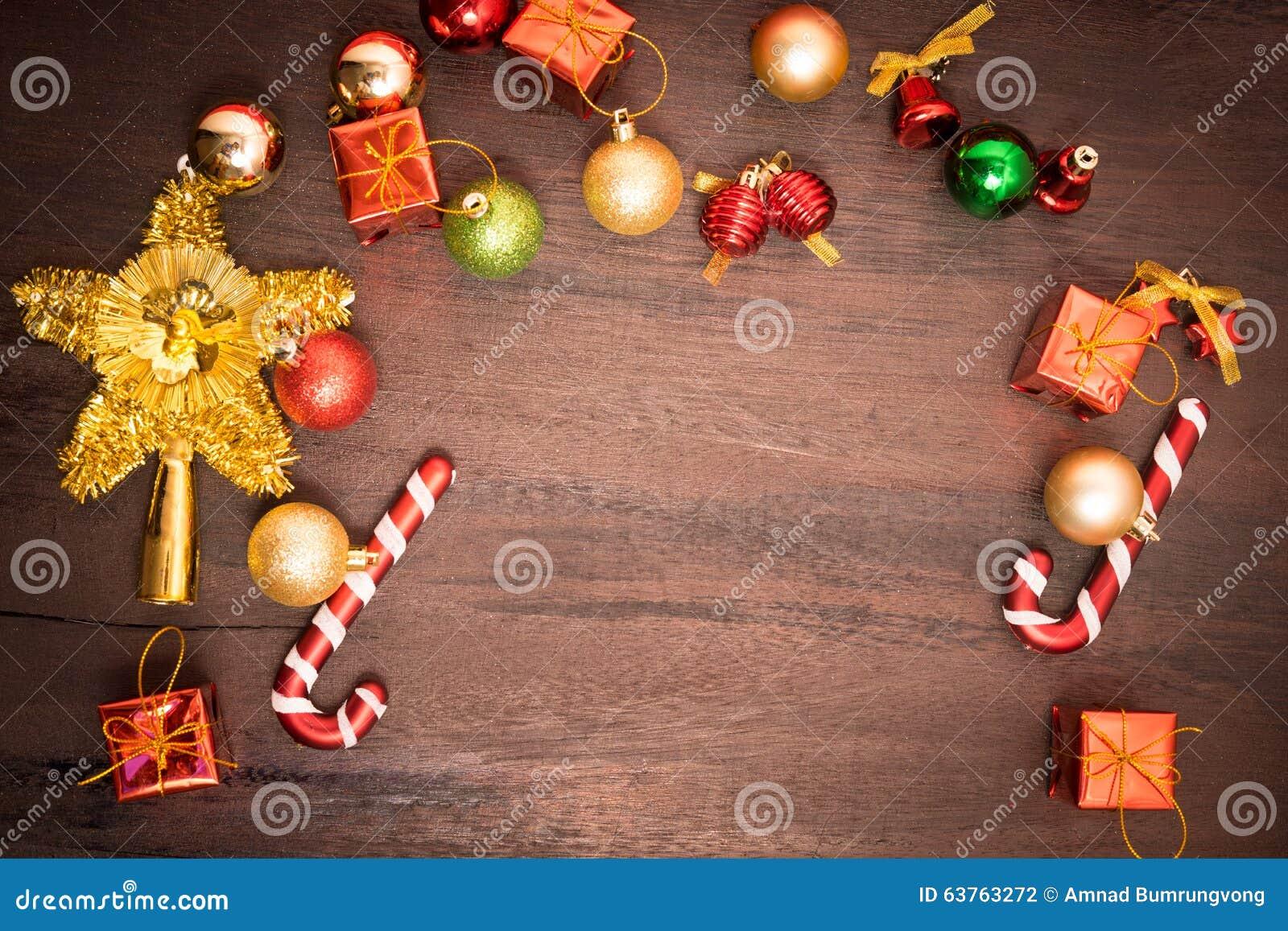Christmas gift box, food decor and fir tree branch on wooden table.Christmas gift box, food decor and fir tree branch on wooden ta