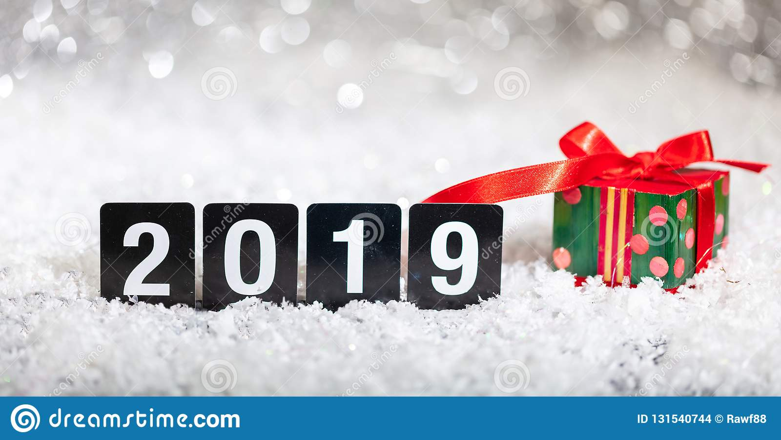 Christmas gift box and new year 2019, on snow, abstract bokeh lights background