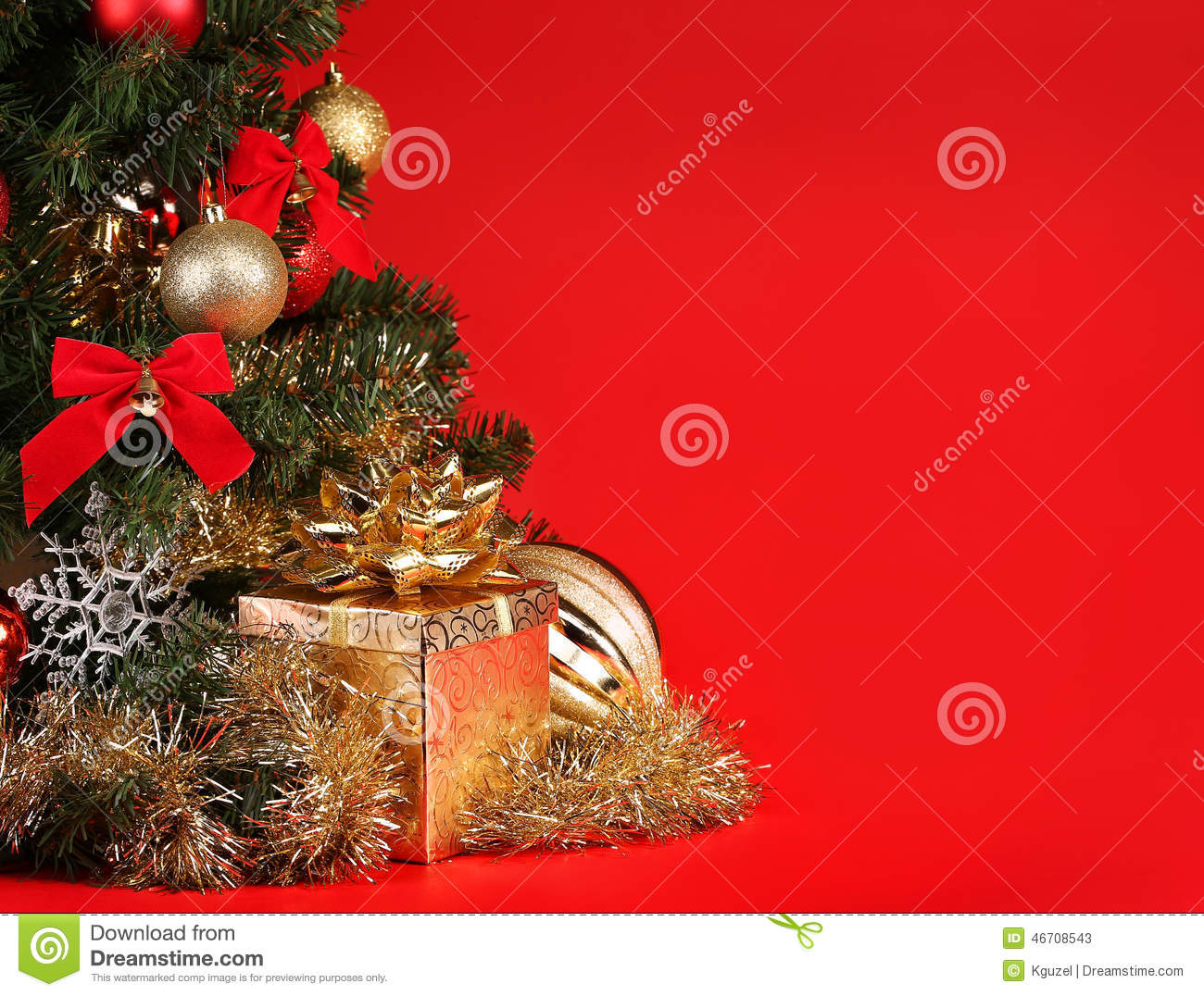 Red Christmas Background With Xmas Tree And Gifts: Christmas. Gift Box Under Christmas Tree Over Red