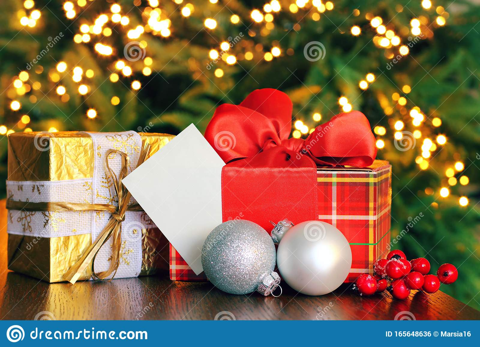 Christmas Gift Boxes With Greeting Card Stock Photo ...