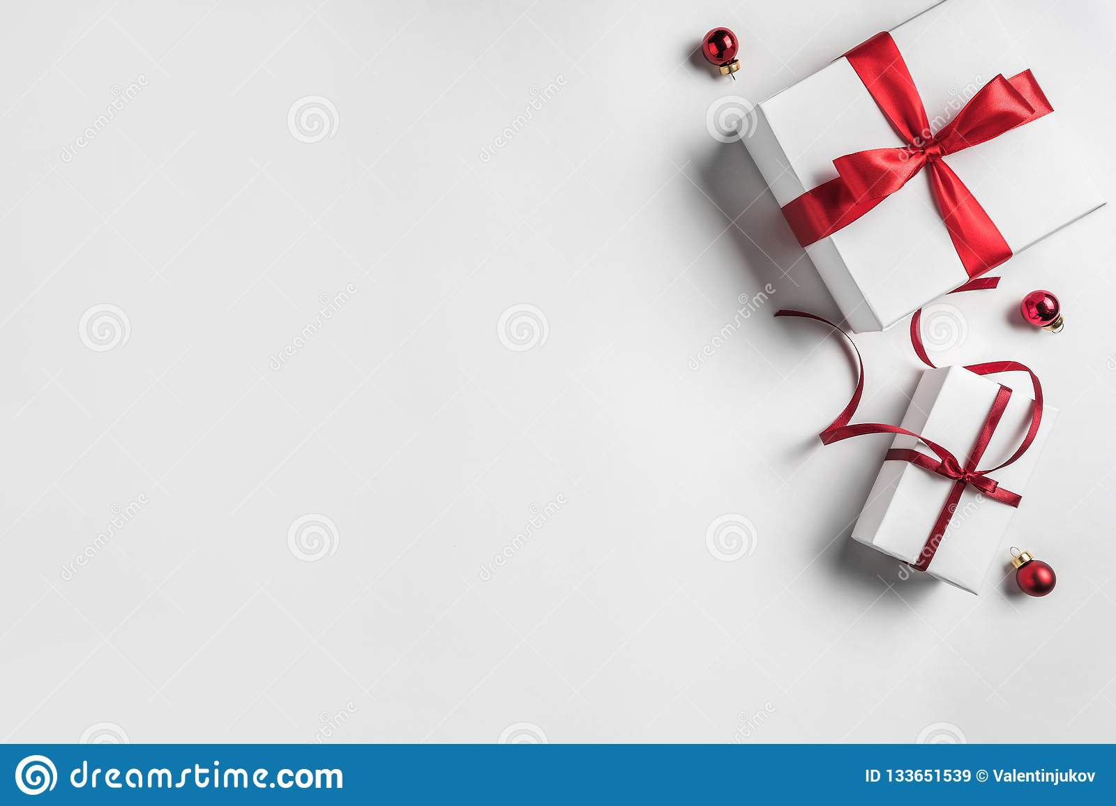 Christmas gift boxes with red ribbon and decoration on white background. Xmas and Happy New Year theme.