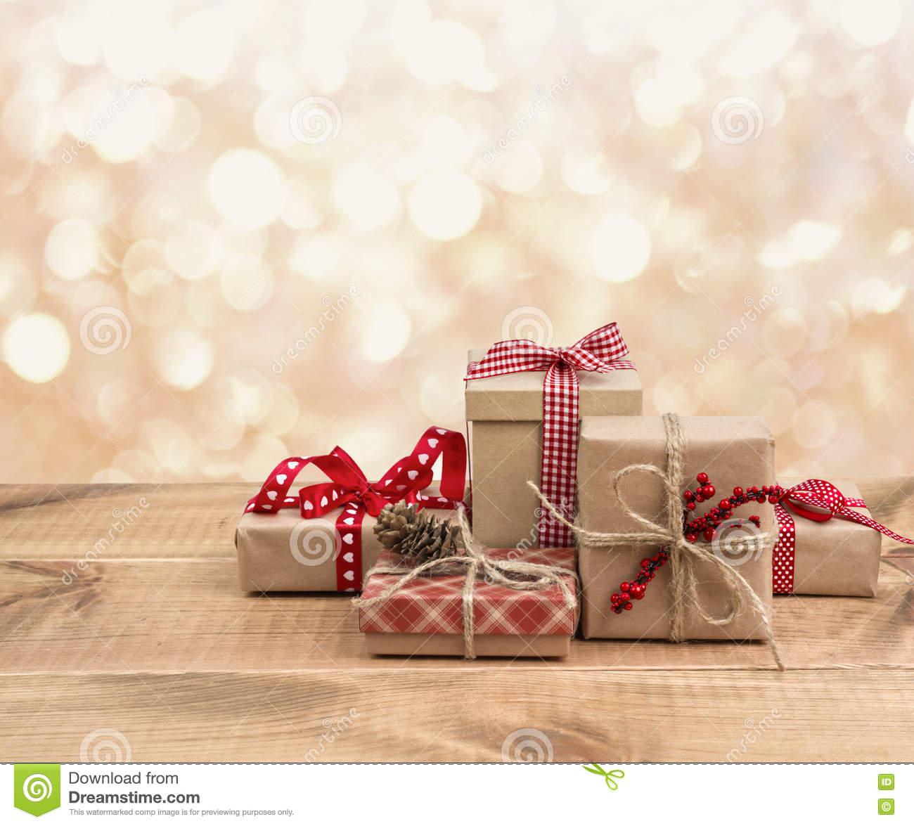 Christmas Gift Background: Christmas Gift Boxes On Wooden Table Over Abstract Lights