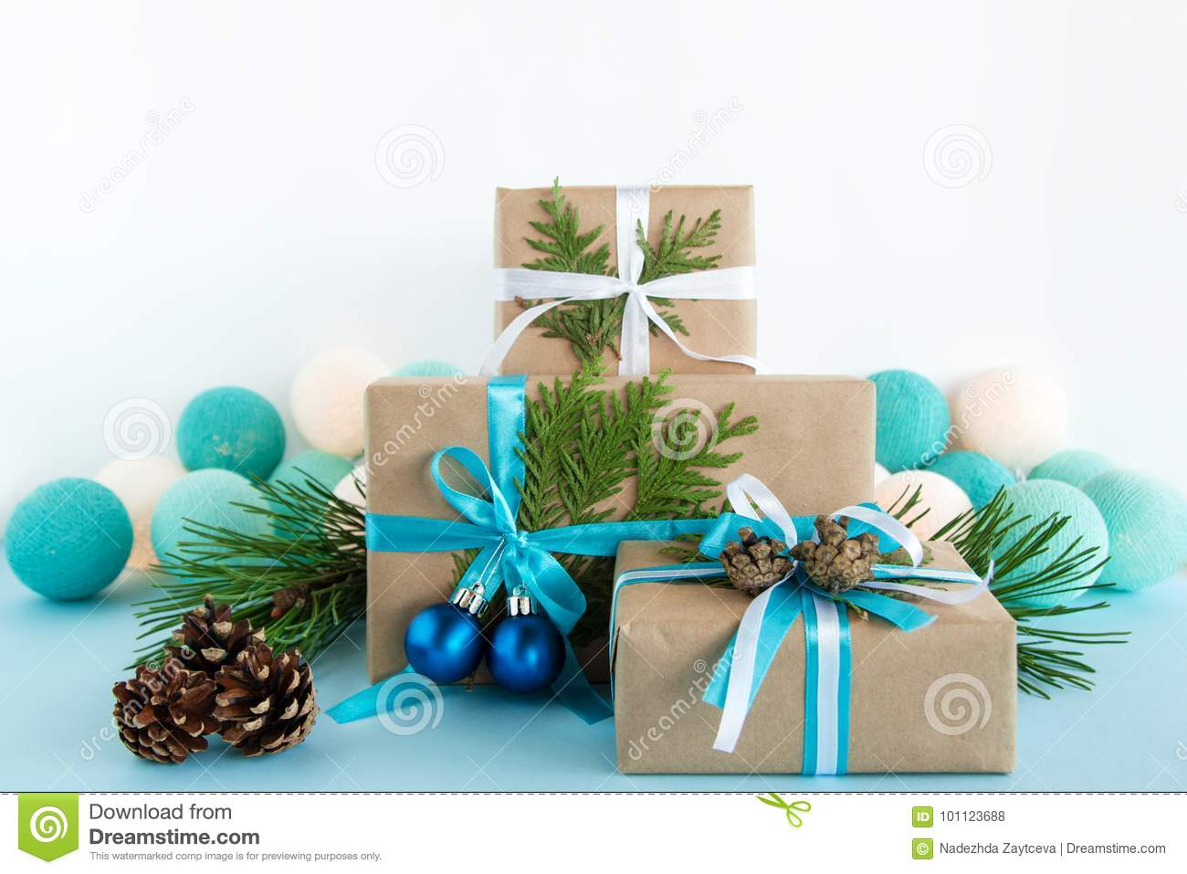 Christmas Gift Boxes Wrapped Of Craft Paper, Blue And White Ribbons ...