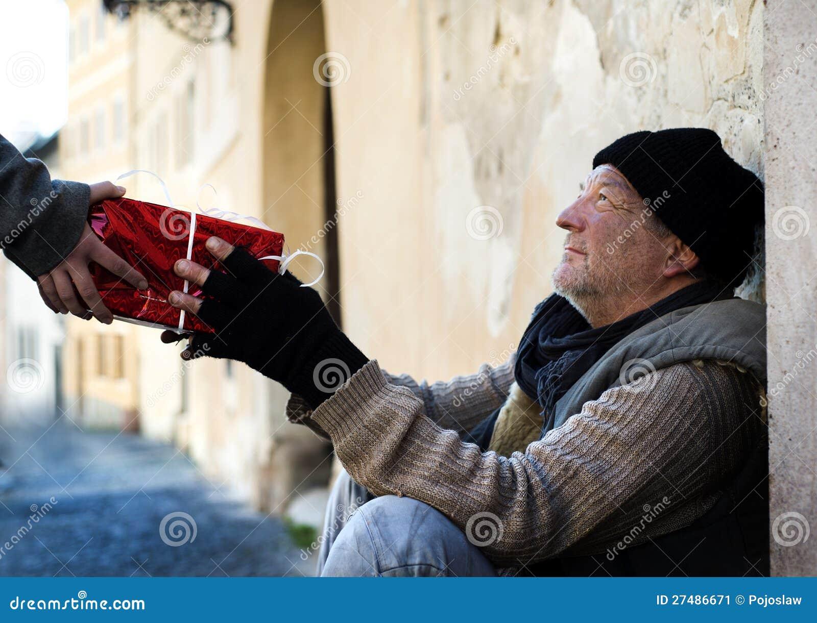 Christmas Gift For Homeless Man Stock Image