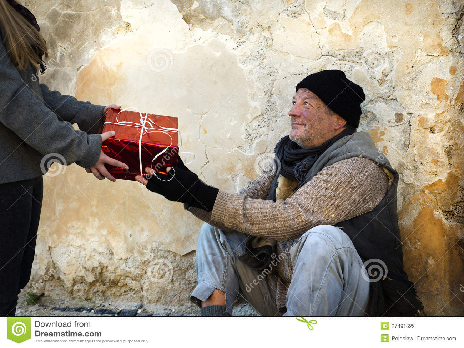 Christmas Gift For Homeless Man Stock Photography