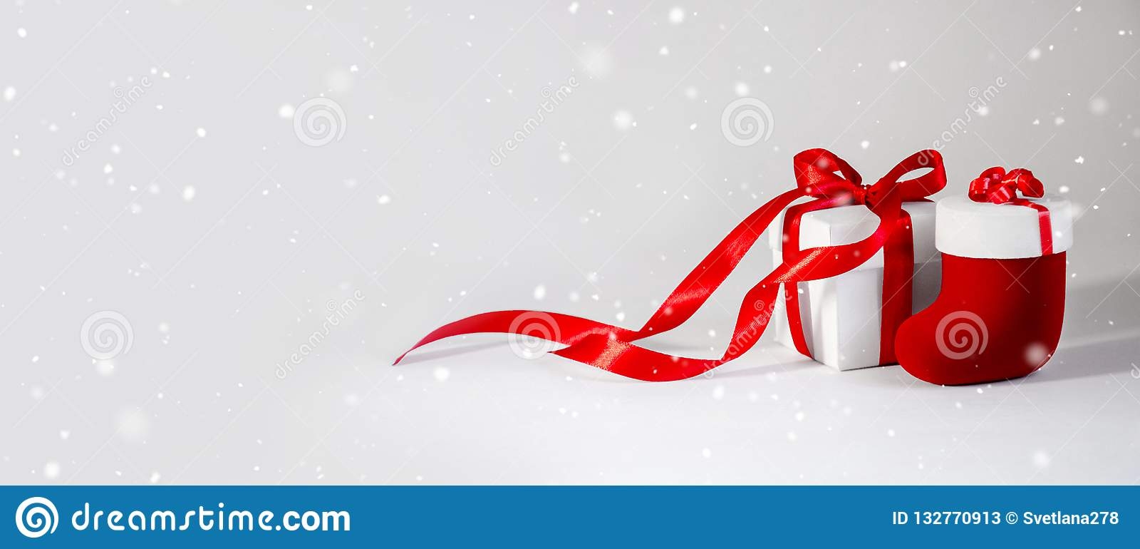 Christmas Gift`s in White Box with Red Ribbon on Light Backgroun