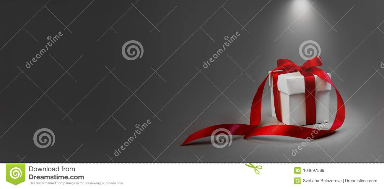 Christmas Gift in White Box Red Ribbon Dark Grey Background. Concept Night Illuminated Lantern New Year Holiday Composition Banner