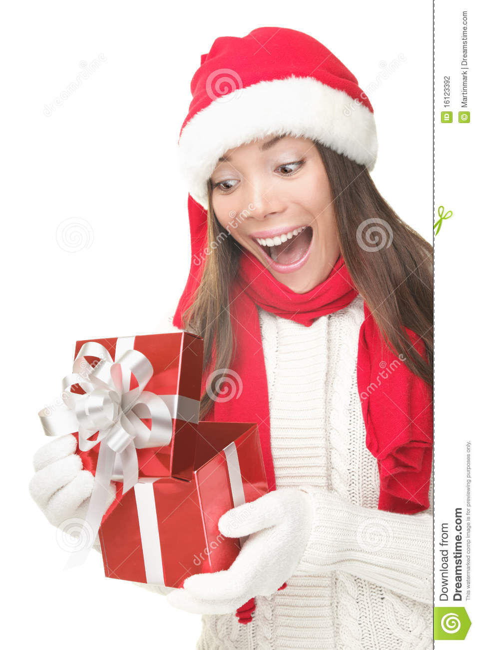 Christmas gift woman opening present surprised