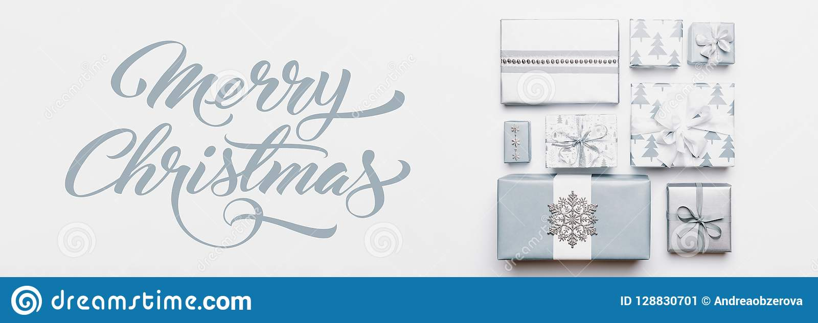 Christmas gifts banner. Beautiful nordic christmas presents isolated on white background. Pastel blue colored wrapped xmas boxes.