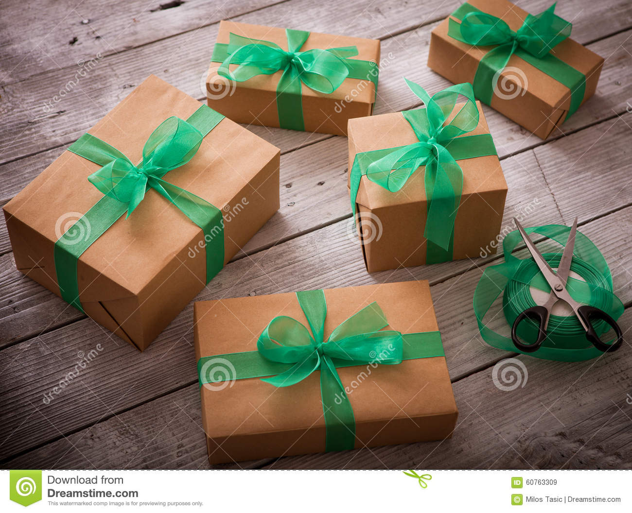 Christmas Gifts Box Presents With Brown Paper And Green Ribbon Stock ...