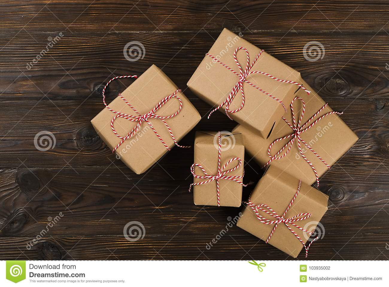 Christmas gifts box presents on wooden background stock photo