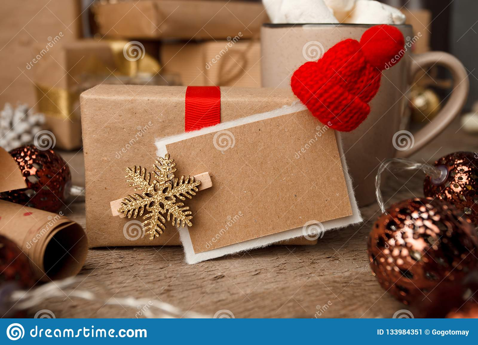 Christmas gifts with christmas decoration on vintage wooden background closeup, design template, copy space, front view.