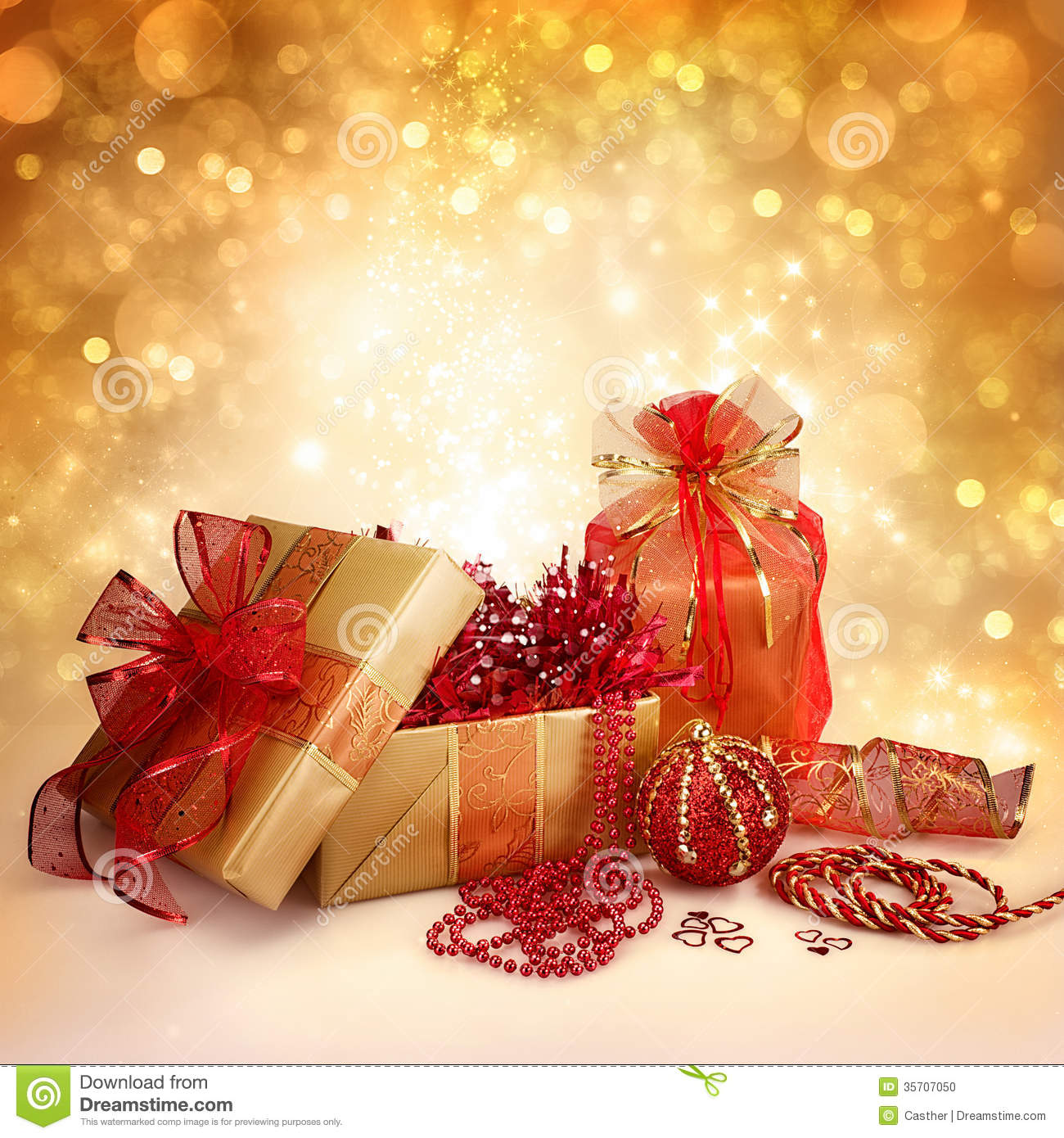 Christmas gifts and decorations in gold red stock