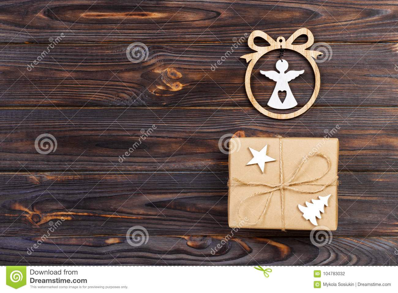 Christmas gifts with statuette of an angel in a frame star and