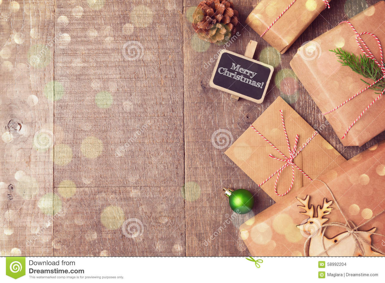 Christmas gifts on wooden background. View from above with copy space