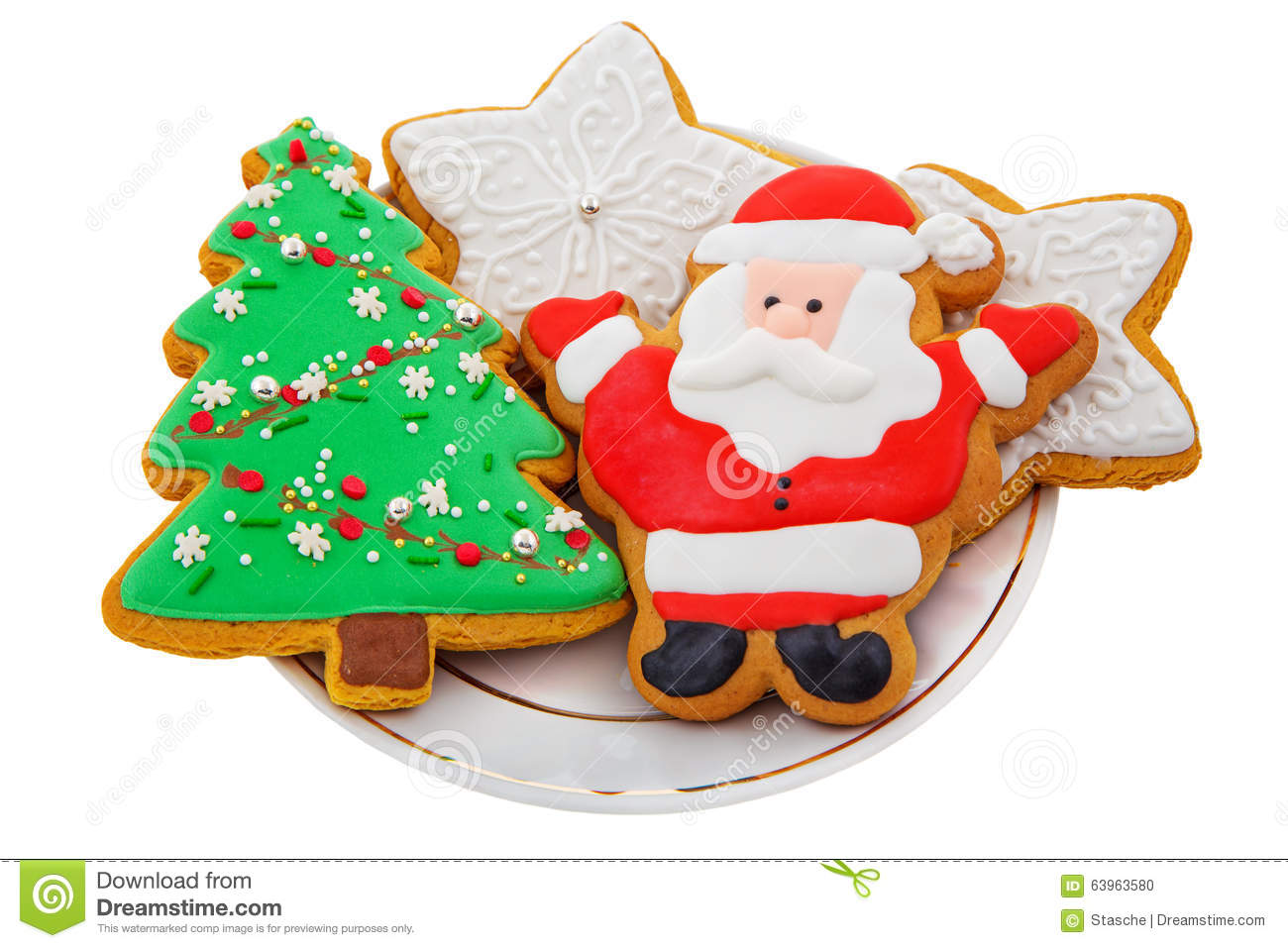 christmas gingerbread colored cookies in the shape of stars santa claus christmas tree on