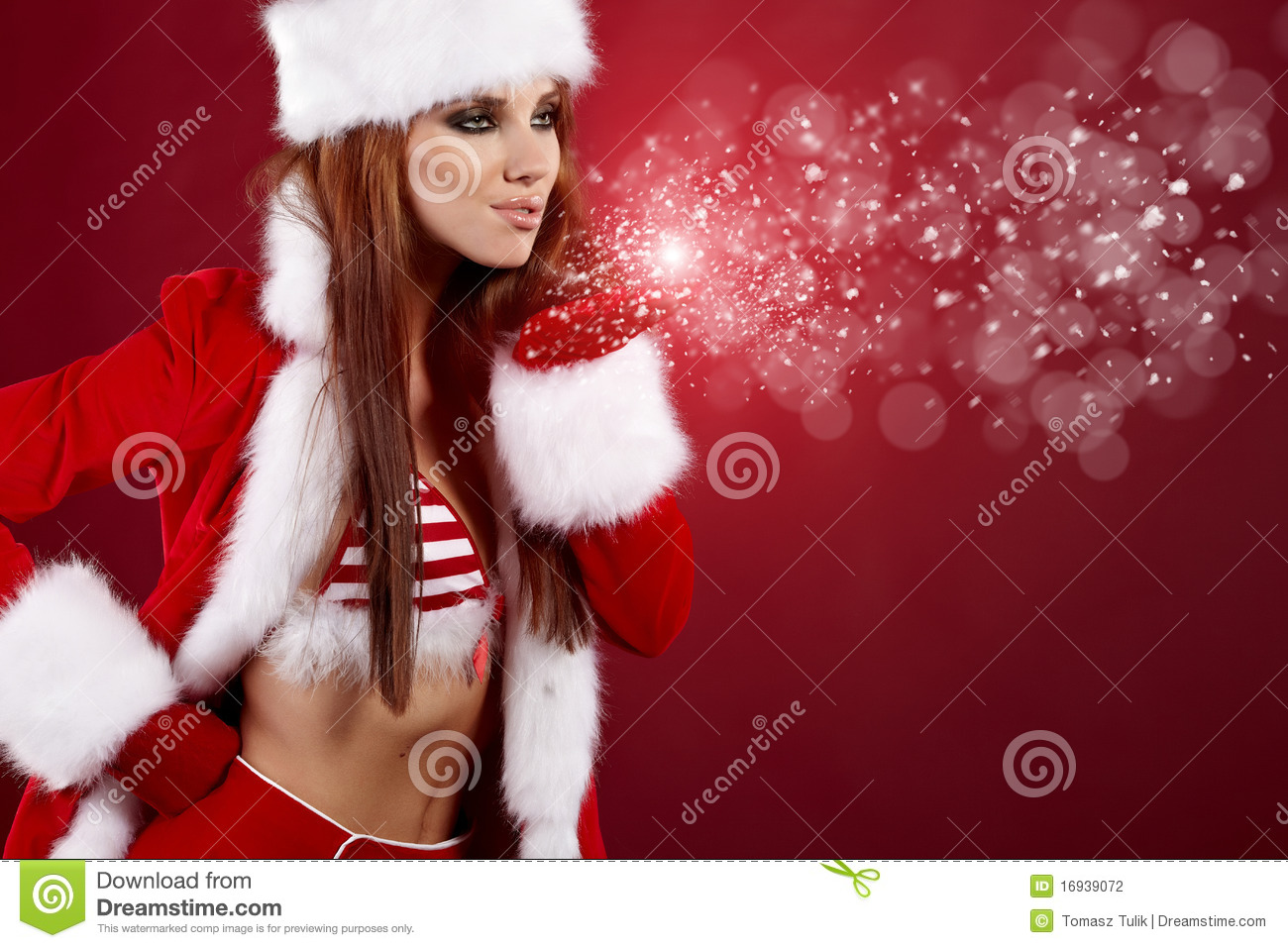 Christmas Girl Blowing Snow. Stock Photo