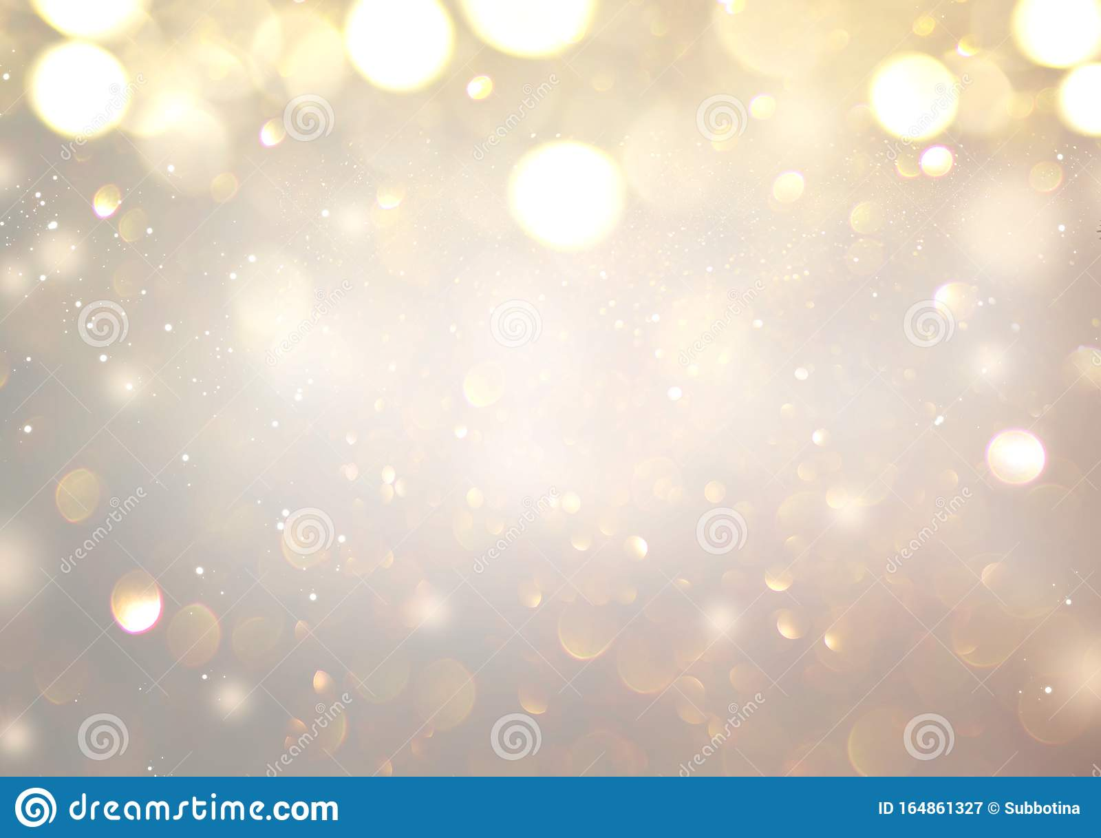 Christmas glowing Golden Background. Christmas lights. Gold Holiday New year Abstract Glitter Defocused Background