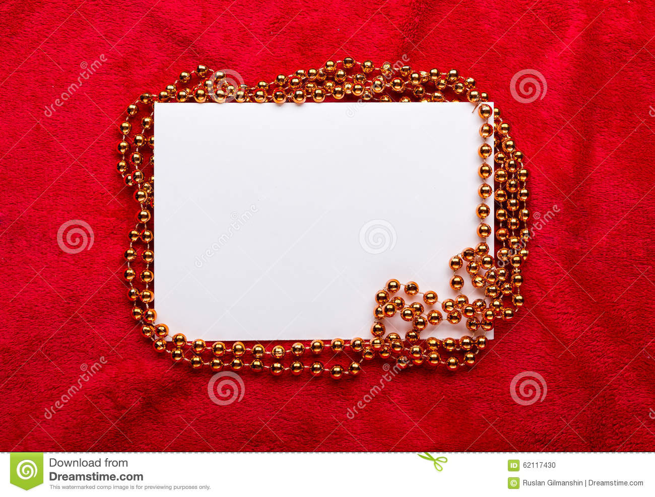Christmas golden beads on red background