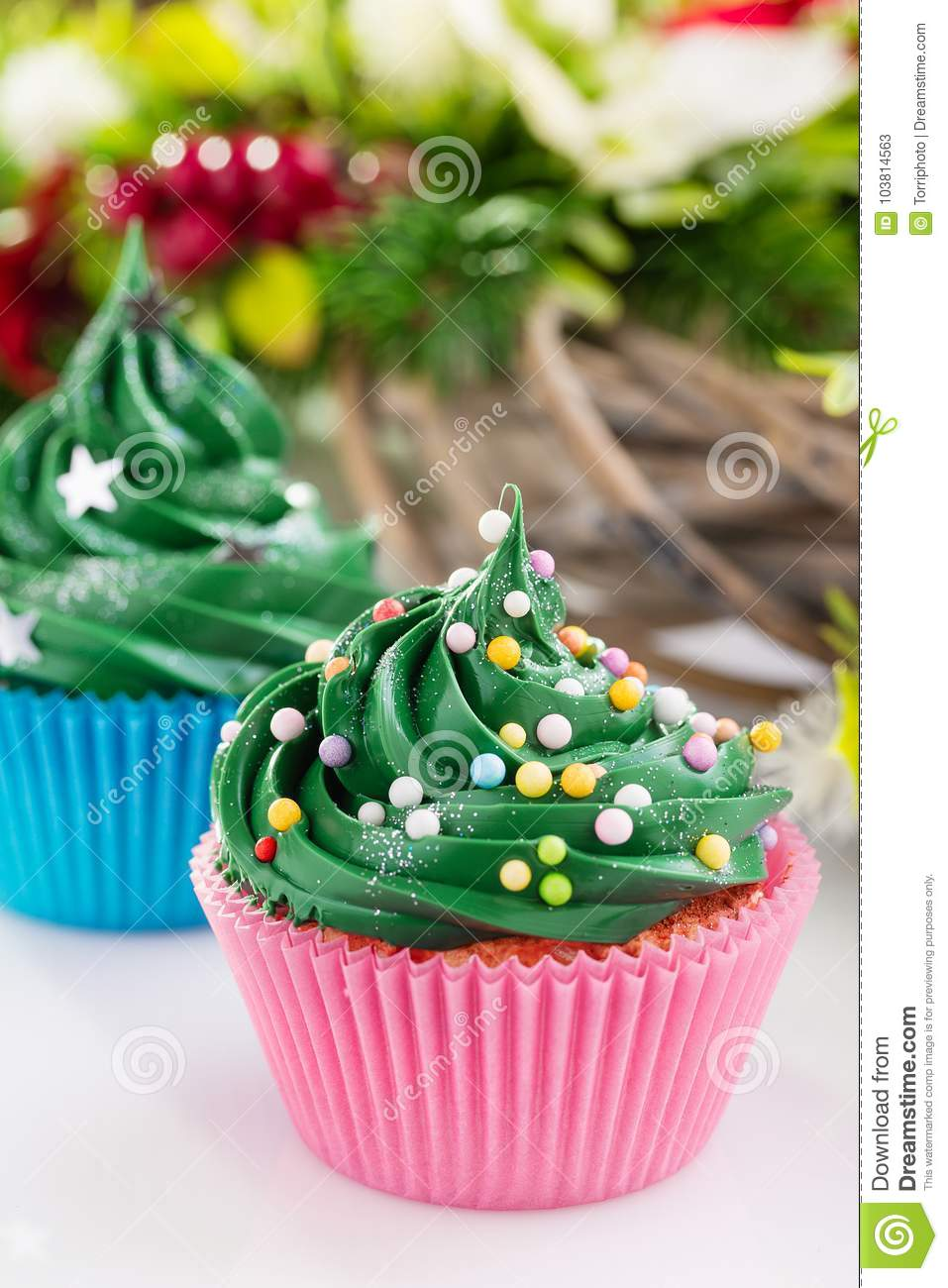 Green christmas cupcaks with festive decorations