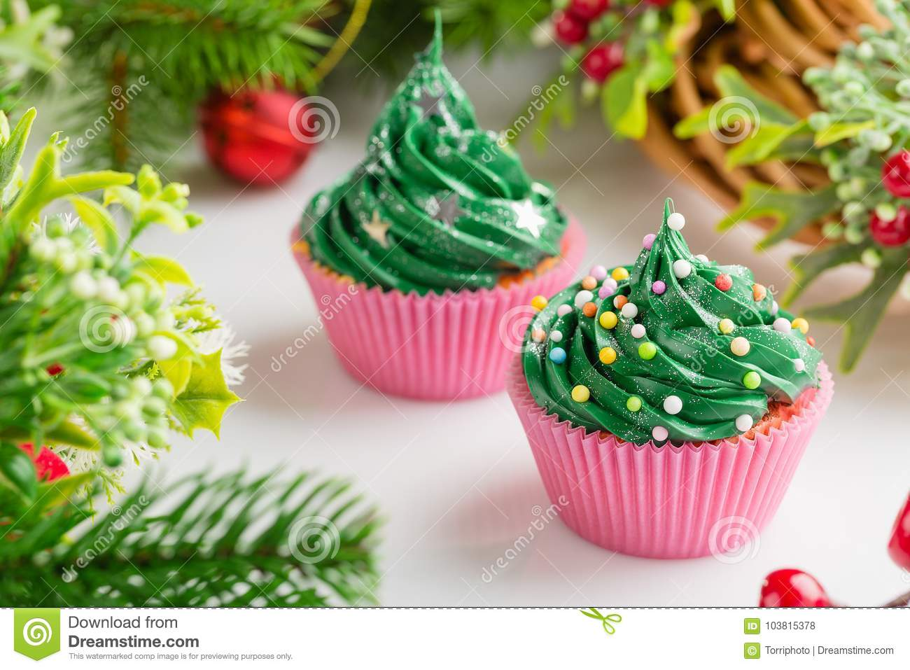 Christmas green cupcakes with festive decorations