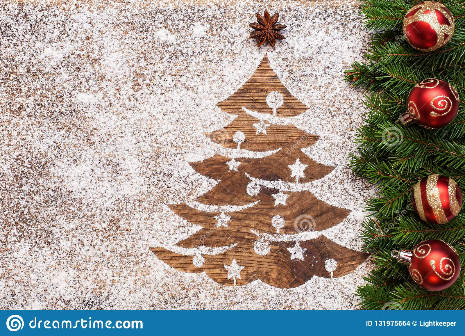 Christmas greeting with xmas tree drawing in sand